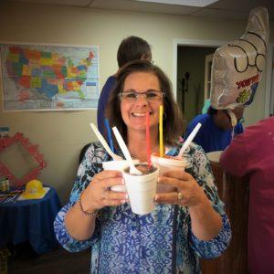 Kendyll Miller, HR Director, hands out snowcones