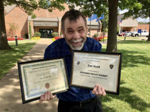 Rex receives certificates from the Oklahoma Police Department